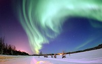Aurora Borealis or Northern Lights, shines above Bear Lake on Eielson Air Force Base, Alaska on 18 January 2005.