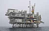 An offshore oil platform (or oil rig), is a large complex structure used to house machinery and workers needed to drill wells in the ocean bed, extract and process crude oil and natural gas, and ship or pipe them to the shore.