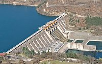 Hydroelectric power plant produces electricity by harnessing the gravitational force of falling or flowing water.