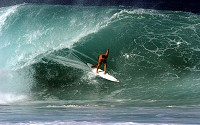 Surfing along the face of a breaking ocean wave is an exciting adventure sport.
