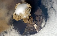 Sarychev Volcano, located in the Kuril Islands, Russia, as seen from the International Space Station in an early stage of eruption on June 12, 2009.