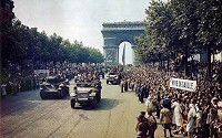 Crowds of French patriots line the Champs Elysees to view Free French tanks and half tracks of General Leclerc's 2nd Armored Division passes through the Arc du Triomphe, after Paris was liberated on August 25, 1944.